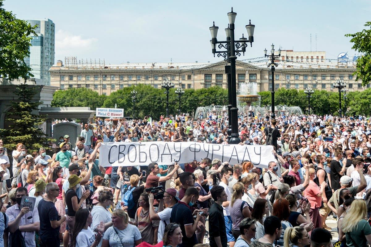 """000_1People hold a banner reading """"Freedom for Furgal!, during an unauthorized rally in support of Sergei Furgal, the governor of the Khabarovsk region in the Russian far eastern city of Khabarovsk on July 18, 2020. (AFP)VD93B"""