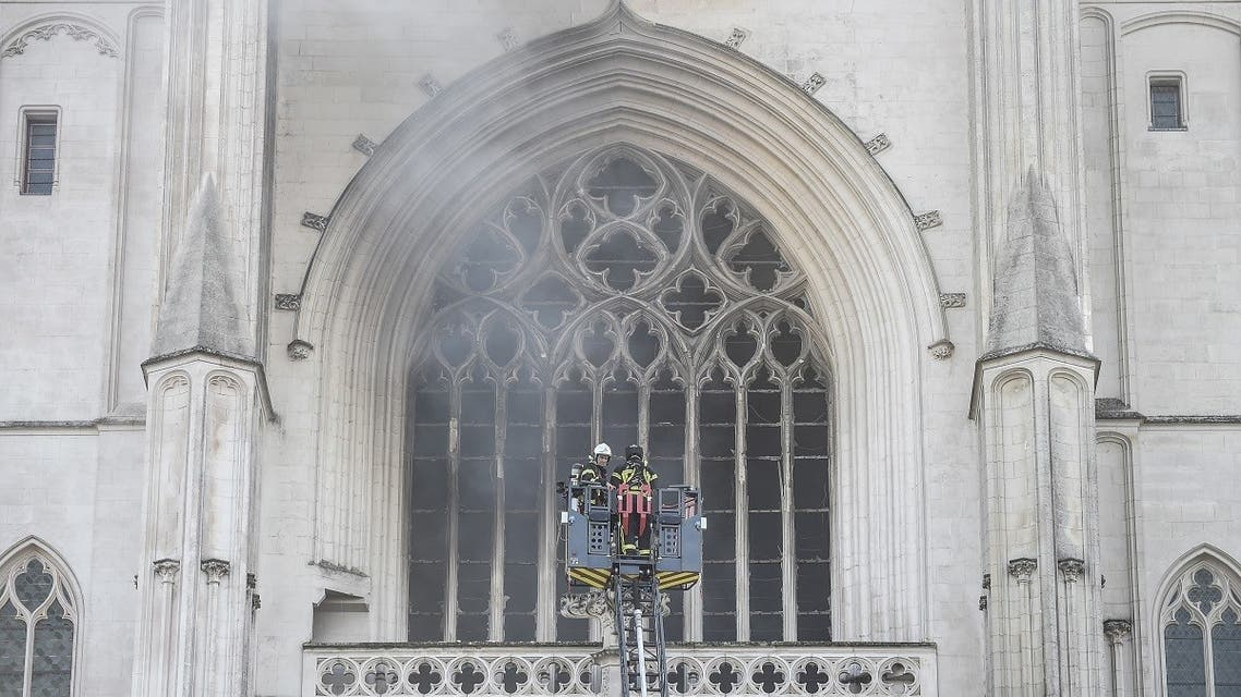 000_1VD8PUFirefighters are at work to put out a fire at the Saint-Pierre-et-Saint-Paul cathedral in Nantes, western France, on July 18, 2020. (AFP)