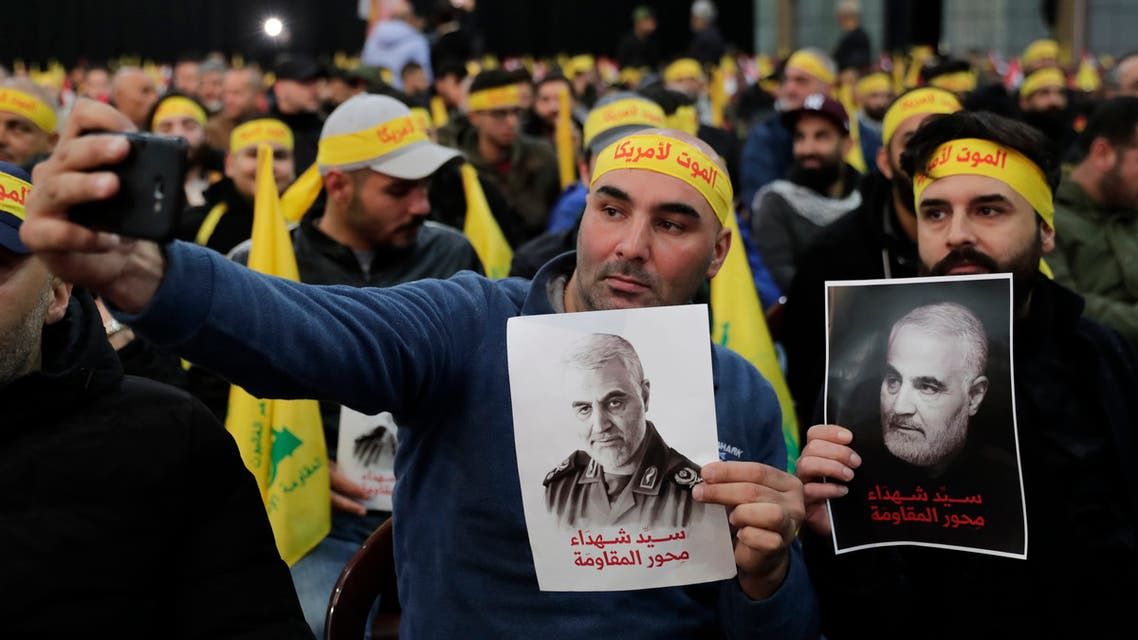 Hezbollah supporters holding posters of slain Iranian general Qasem Soleimani Beirut's southern suburbs on January 5, 2020. (File Photo: Reuters)