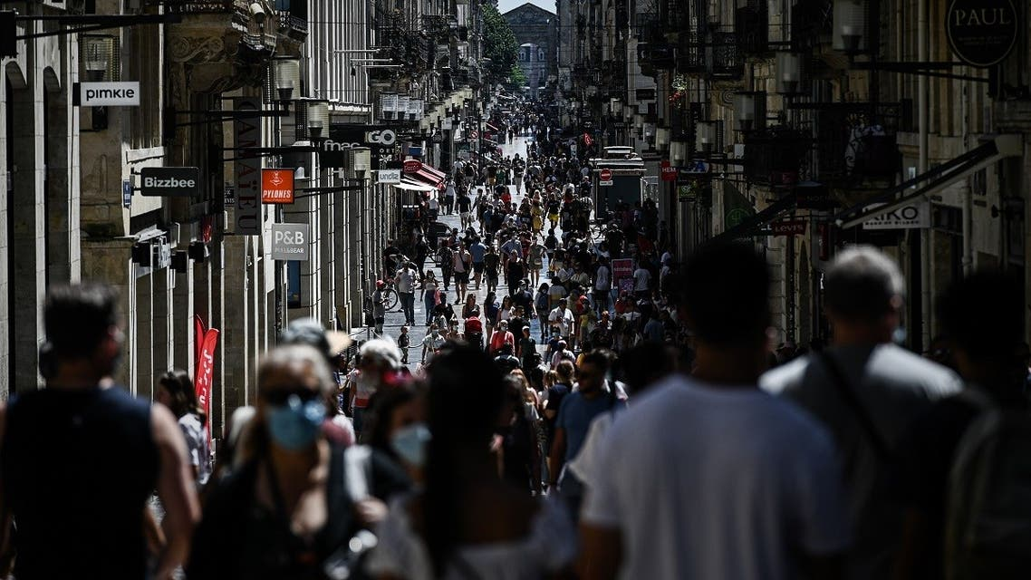 Pedestrians walk in a street lined with shops in Bordeaux, southern France, on July 19, 2020. (AFP)