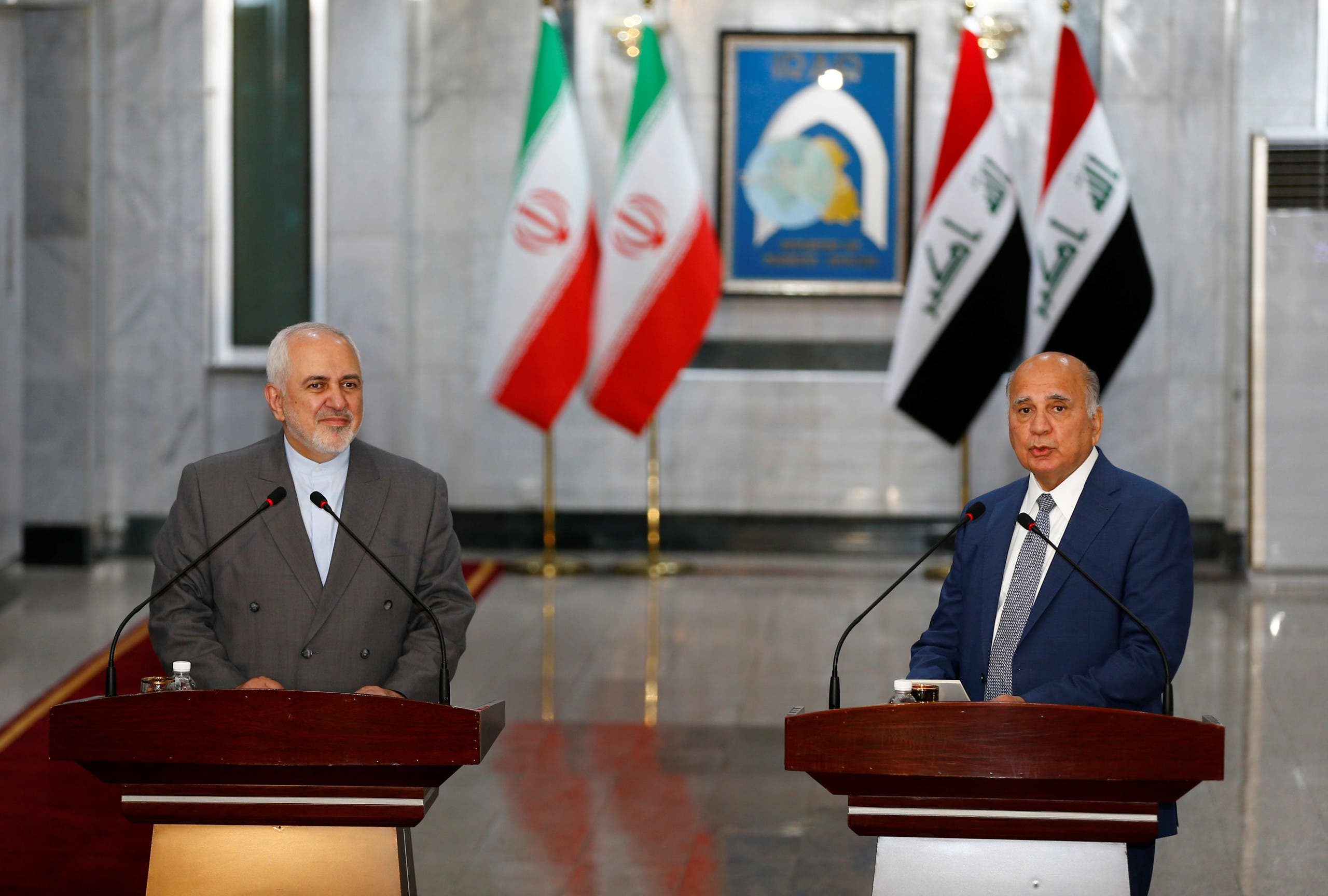 Iran's Foreign Minister Mohammad Javad Zarif with Iraqi Foreign Affairs Minister Fuad Hussain in Baghdad, Iraq, July 19, 2020. (Reuters)