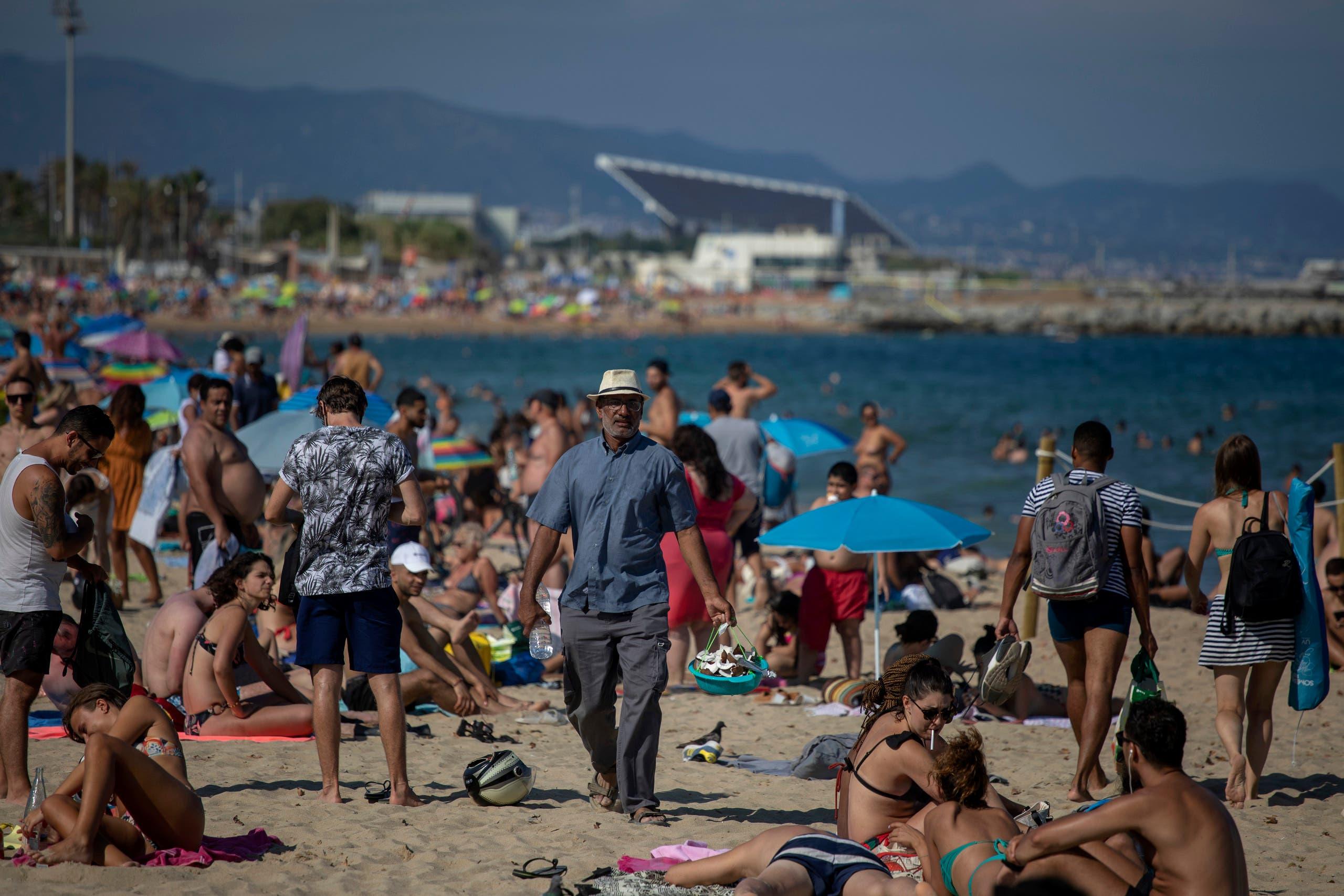 People enjoy the beach in Barcelona on July 18, 2020. (AP)