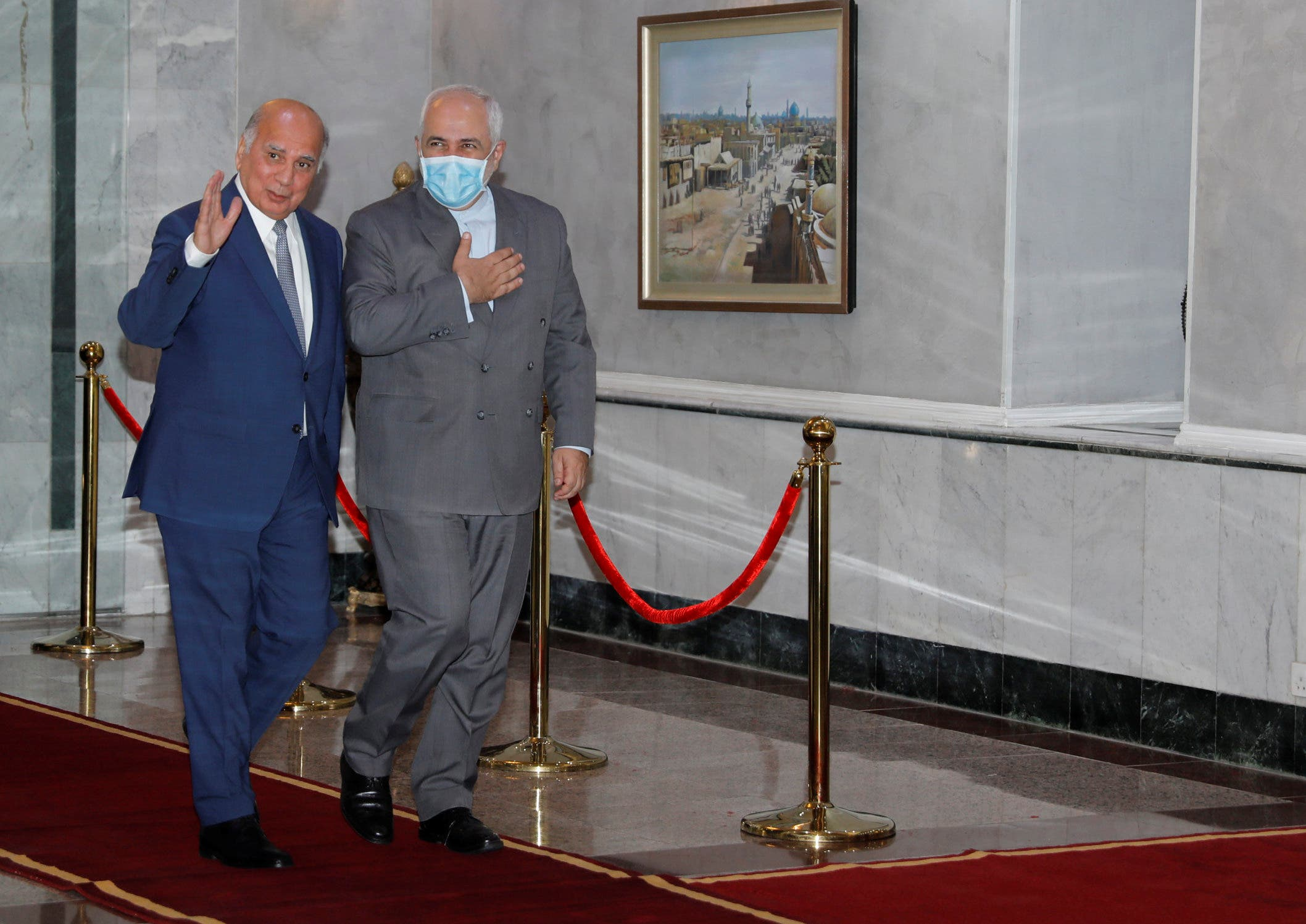 Iran's Foreign Minister Mohammad Javad Zarif walks with Iraqi Foreign Affairs Minister Fuad Hussain in Baghdad, Iraq, July 19, 2020. (Reuters)
