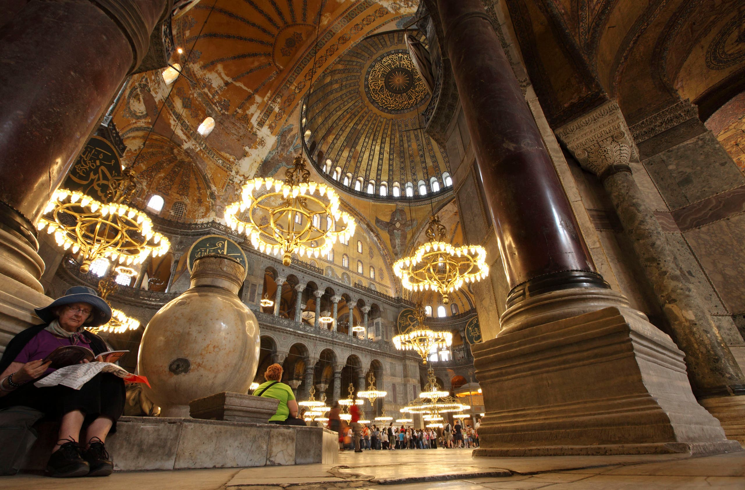 A foreign tourist pauses as she visits the Byzantine monument of Hagia Sophia on May 25, 2011. (AFP)