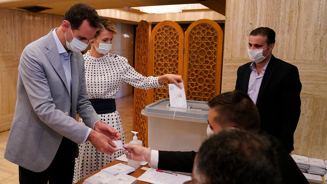 Syrian President Bashar Assad and his wife Asma vote at a polling station in the parliamentary elections in Damascus, Syria on July 19, 2020. (AP)