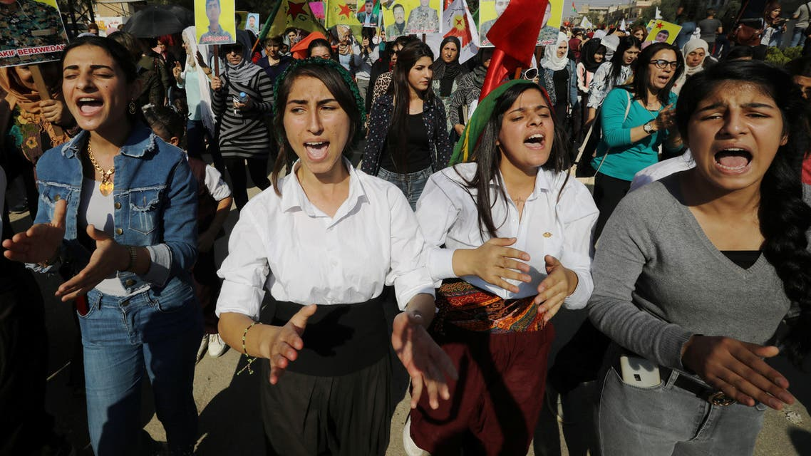 Kurdish and Arab protesters chant slogans against Turkish President Erdogan during a march to the United Nations Headquarters in the town of Qamishli, Syria on October 23, 2019. (Reuters)