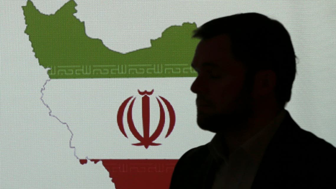 Director at one of FireEye's subsidiaries, stands in front of a map of Iran as he speaks to journalists about the techniques of Iranian hacking, on Sept. 20, 2017, in Dubai.  (File photo: AP)