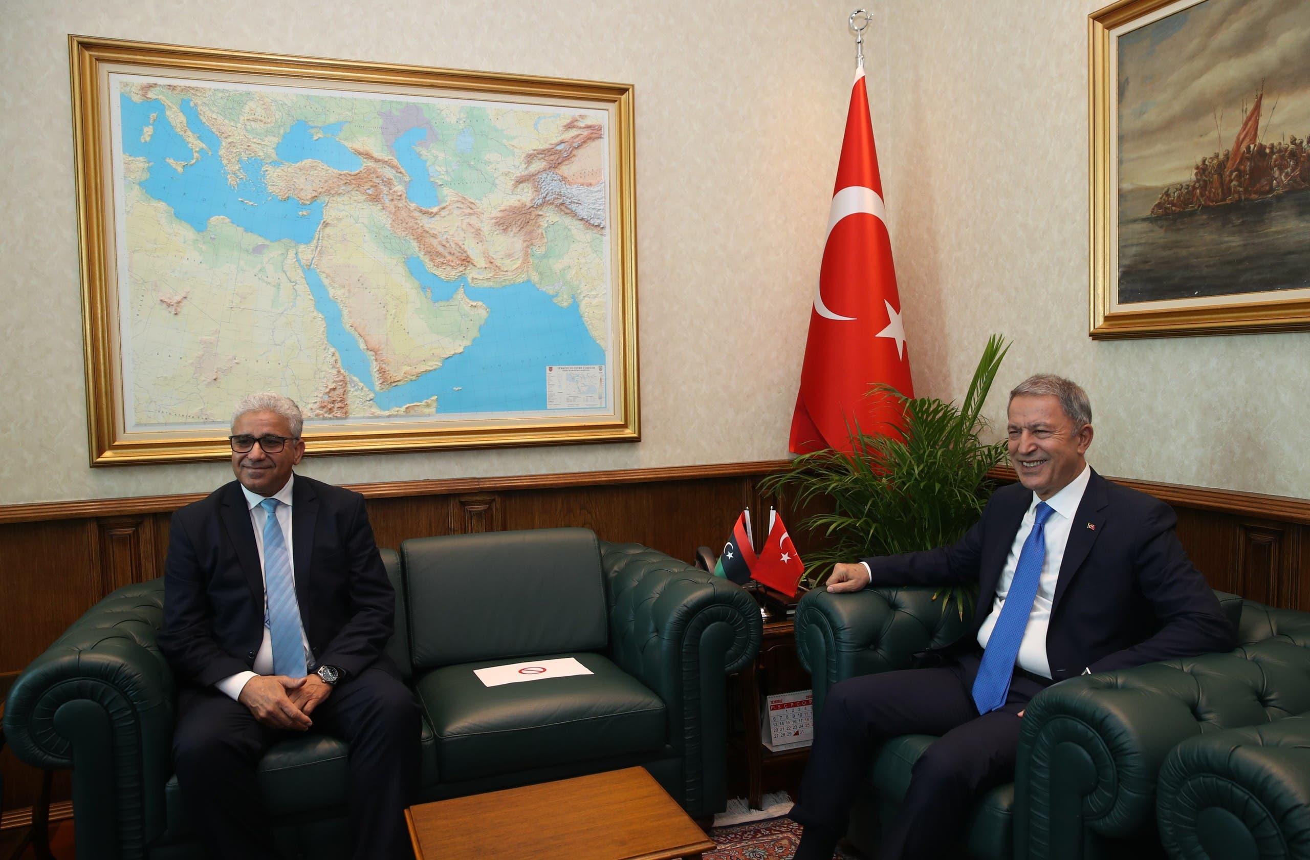 وزير الدفاع التركي خلوصي أكار ووزير الداخلية في حكومة الوفاق الليبية فتحي باشاغا