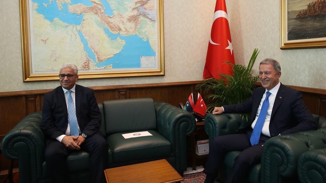 وزير الدفاع التركي خلوصي أقار الإثنين وزير الداخلية في حكومة الوفاق الليبية فتحي باشاغا