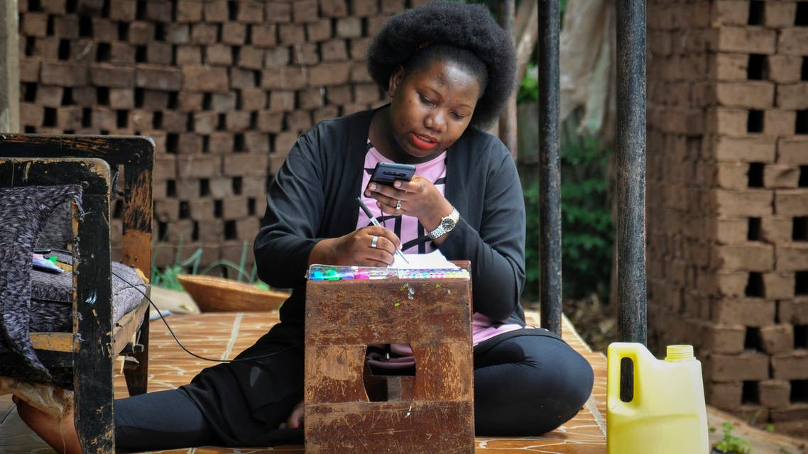 Stella Maris Basemera, a mathematics teacher who heads a Uganda-based group of tutors called Creative Learning Africa, writes work for students to complete which she sends them as a private tutor via WhatsApp, at her home just outside Kampala, Uganda Tuesday, July 7, 2020. (AP)