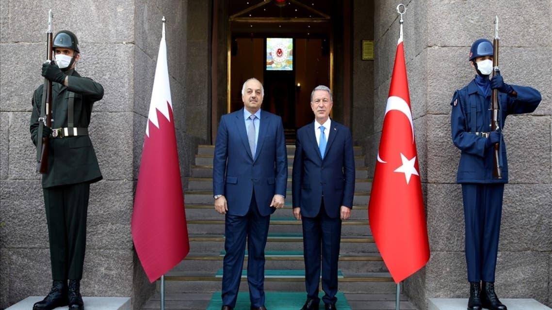 Qatar's Minister of State for Defense Affairs Khalid bin Mohammed al-Atiyya and Turkish Defense Minister Hulusi Akar in Ankara, Turkey. (Screengrab)
