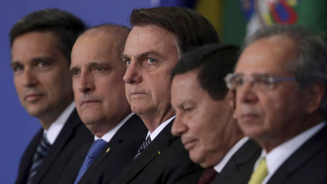 Brazil's President Jair Bolsonaro, center, stands next to the President of the Central Bank, Roberto Campos Neto, left, Chief of Staff Onix Lorenzoni, second left, Vice President Hamilton Mourao, second right, and the Minister of Economy, Paulo Guedes, right. (File photo: AP)