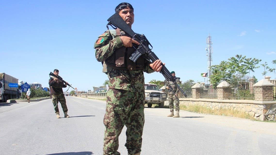Afghan National Army officers stand guard at the site of a blast in Ghazni province, Afghanistan, on May 18, 2020. (Reuters)