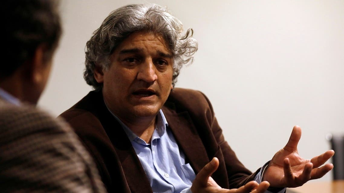 Matiullah Jan, a journalist and columnist, gestures during an interview with Reuters at his office in Islamabad, Pakistan March 13, 2019. (Reuters)