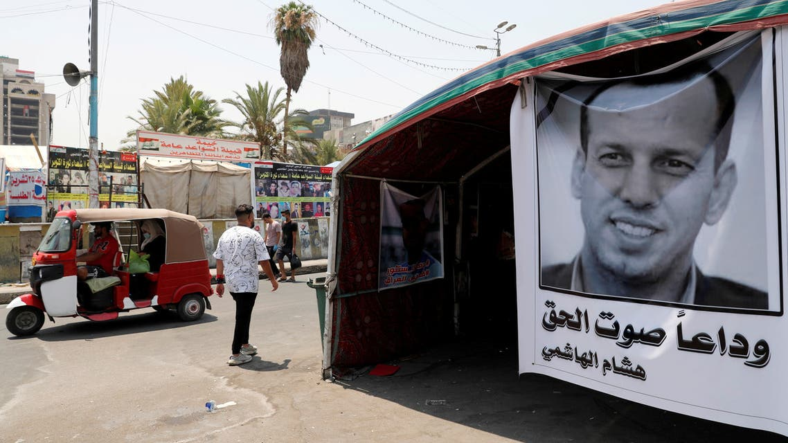 A poster depicting the former government advisor and political analyst Hisham al-Hashemi, who was killed by gunmen is seen at the Tahrir Square in Baghdad. (Reuters)