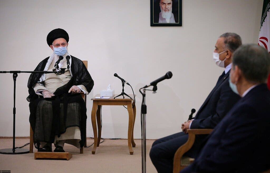 Iran's Supreme Leader Ayatollah Ali Khamenei meets with Iraqi Prime Minister Mustafa al-Kadhimi as they wear protective masks, in Tehran. (Reuters)