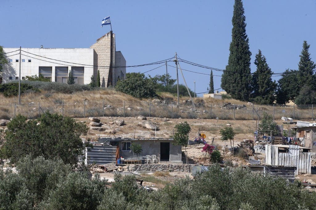 A picture taken from the Palestinian village of Al-Issifer shows a building in the Israeli settlement of Yattir overlooking the village, south of Yatta town, in the occupied West Bank, on July 12, 2020. (File photo: AFP)