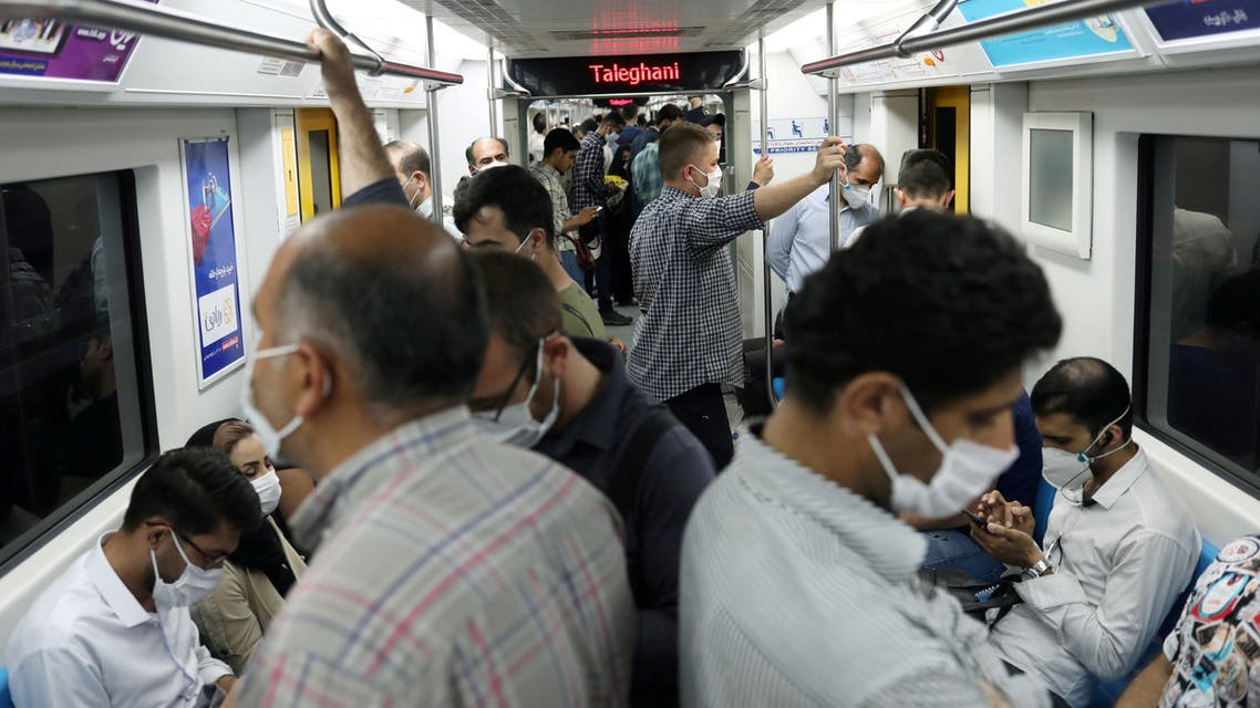 FILE PHOTO: Iranians wearing protective face masks ride the metro, following the outbreak of the coronavirus disease (COVID-19), in Tehran, Iran, June 28, 2020. WANA (West Asia News Agency) via REUTERS ATTENTION EDITORS - THIS PICTURE WAS PROVIDED BY A THIRD PARTY/File Photo