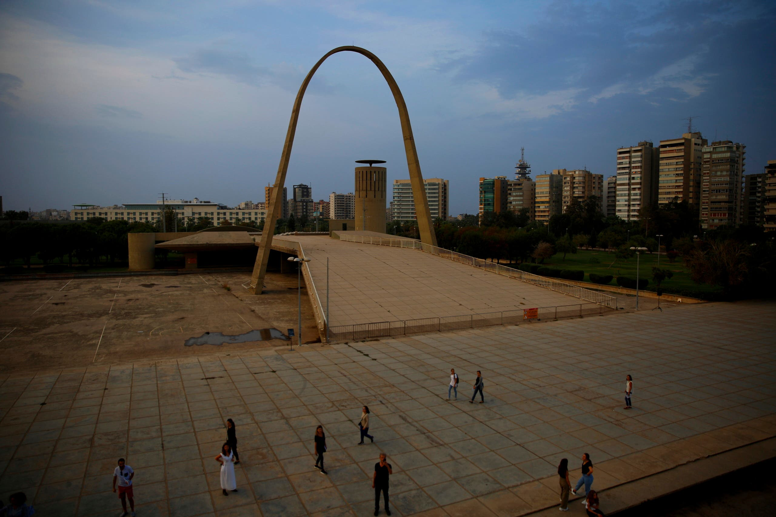 In this Saturday, Oct. 20, 2018 photo, visitors tour The Open Air Theater, designed in the early 1960s by the late Brazilian architect Oscar Niemeyer, at the Rashid Karami International Fair, in the northern city of Tripoli, Lebanon. The fairground has just been included on the list of sites eligible for listing on the World Heritage of Humanity by UNESCO. (AP)