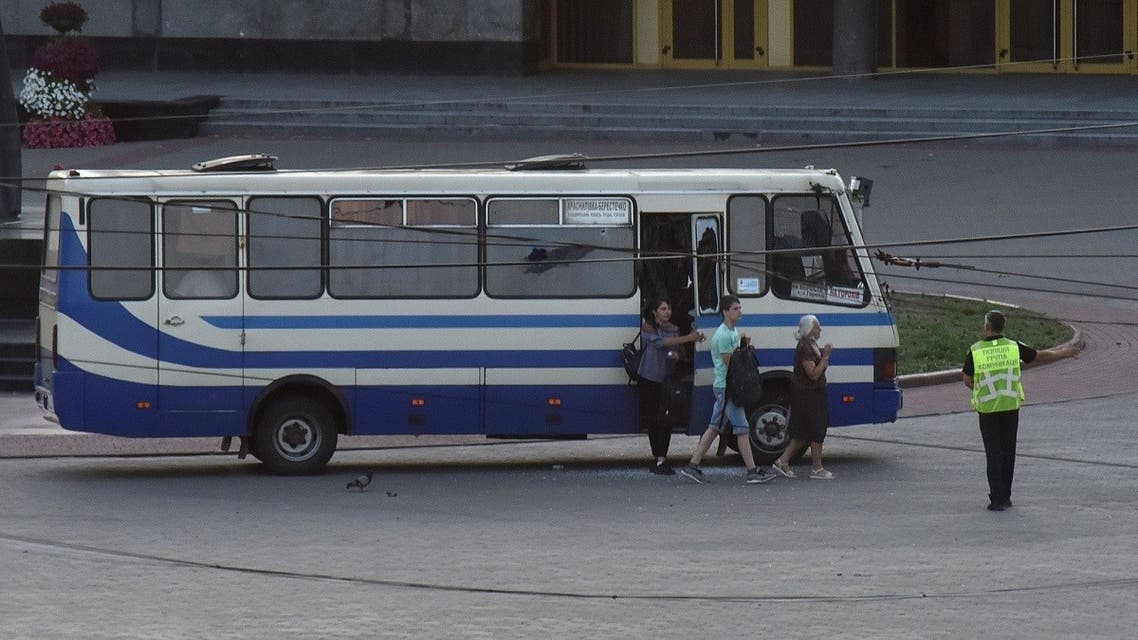 Three hostages walk out of a seized passenger bus in the city of Lutsk, Ukraine July 21, 2020. (Reuters)