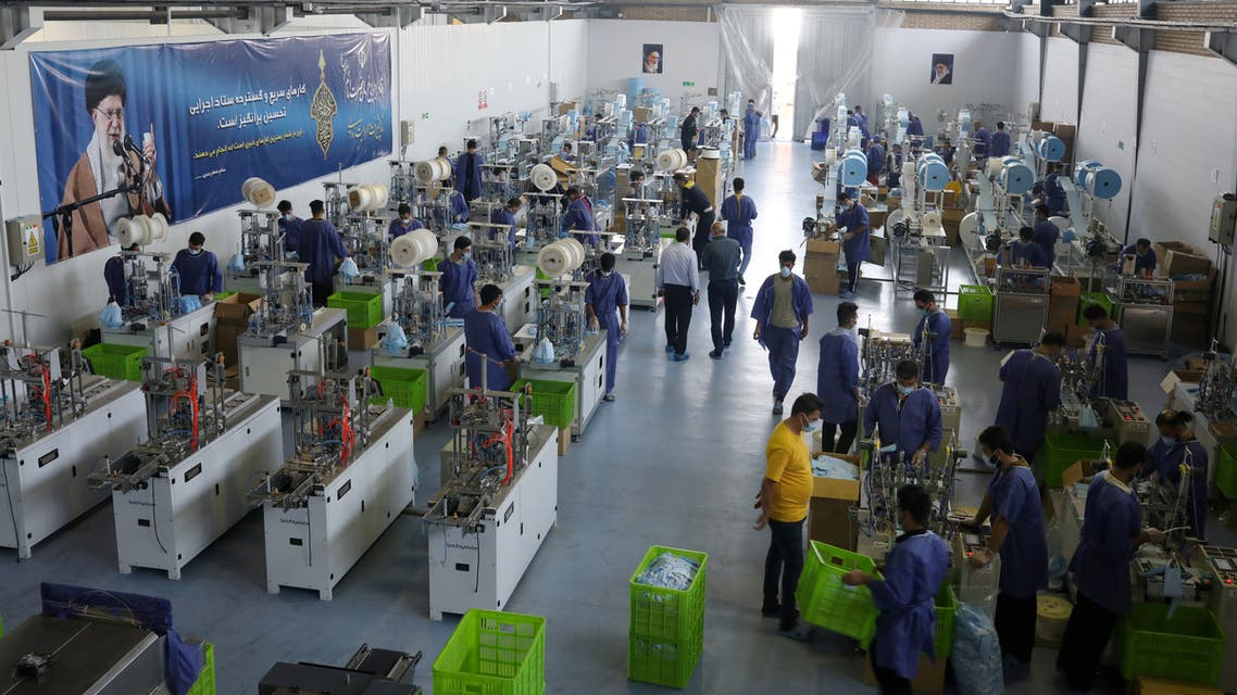 General view of a production line manufacturing face masks at a factory, following the outbreak of the coronavirus disease (COVID-19), in Karaj, Iran, June 28, 2020. (Reuters)