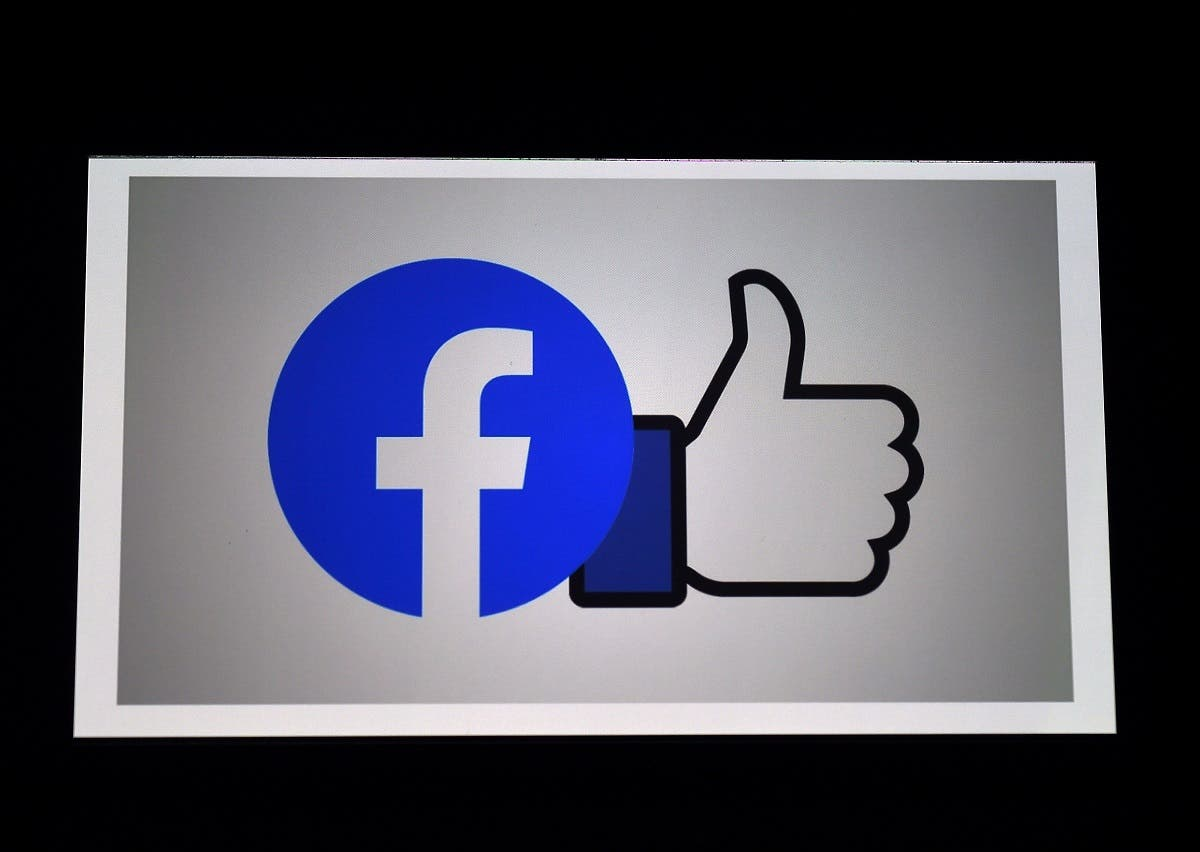 In this file photo illustration a Facebook App logo is displayed on a smartphone on March 25, 2020 in Arlington, Virginia. (AFP)