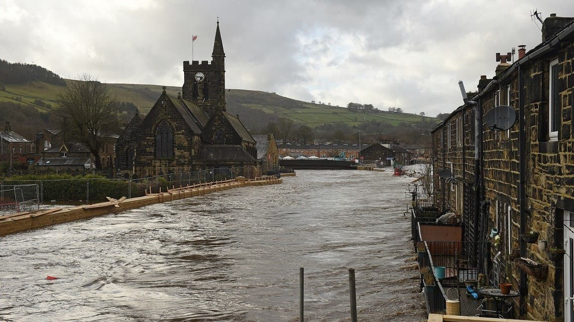 Newly constructed flood defenses are seen beside the River Calder in Mytholmroyd, northern England, on February 9, 2020. (AFP)