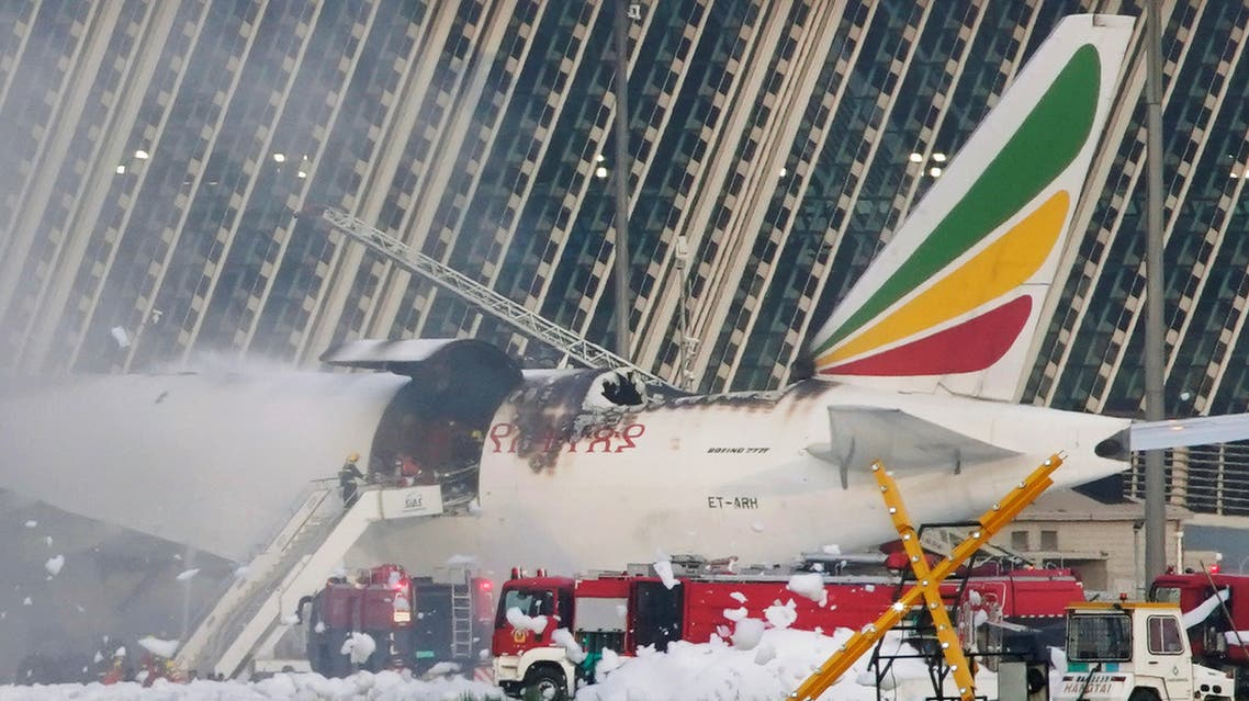 Firefighters work to extinguish the Ethiopian Airlines cargo plane that caught fire at Shanghai Pudong International Airport. (Reuters)