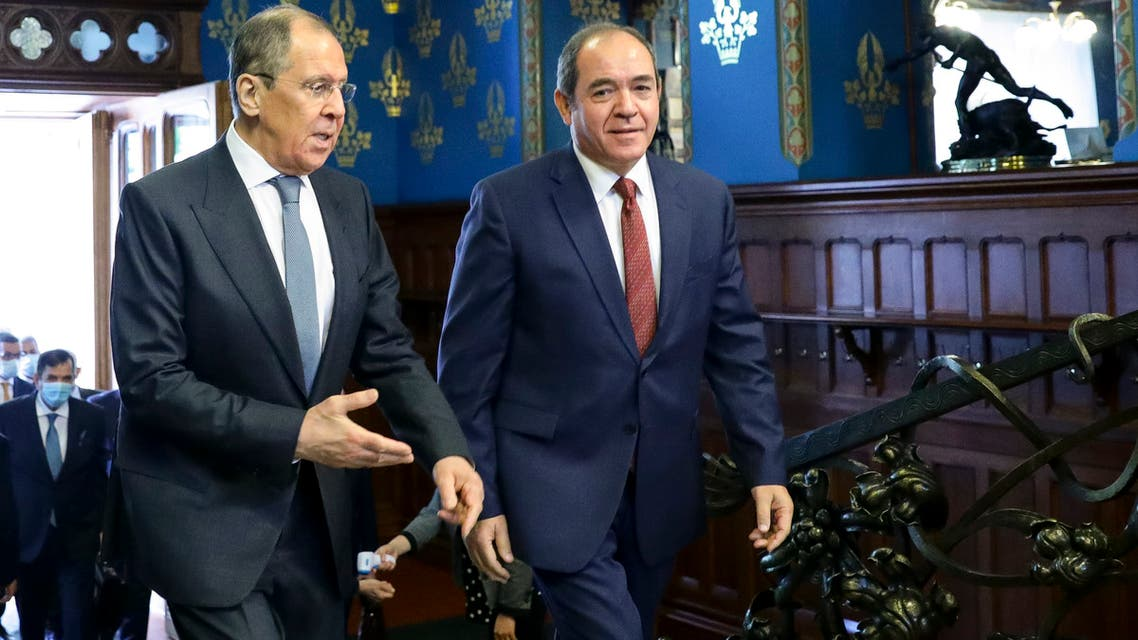 In this photo taken on Wednesday, July 22, 2020, and distributed by Russian Foreign Ministry Press Service, Russian Foreign Minister Sergey Lavrov, left, and Algerian Foreign Minister Sabri Boukadoum talk as they enter a hall for their talks in Moscow, Russia. (Russian Foreign Ministry Press Service via AP)