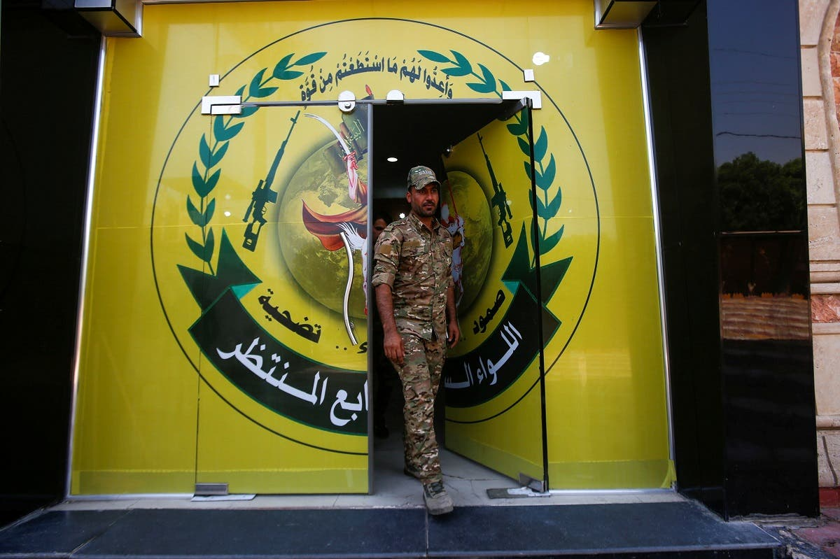 A member of Iraqi Popular Mobilisation Unit (PMU) militias walks out from the headquarters of the seventh brigade in Basra. (File photo: Reuters)