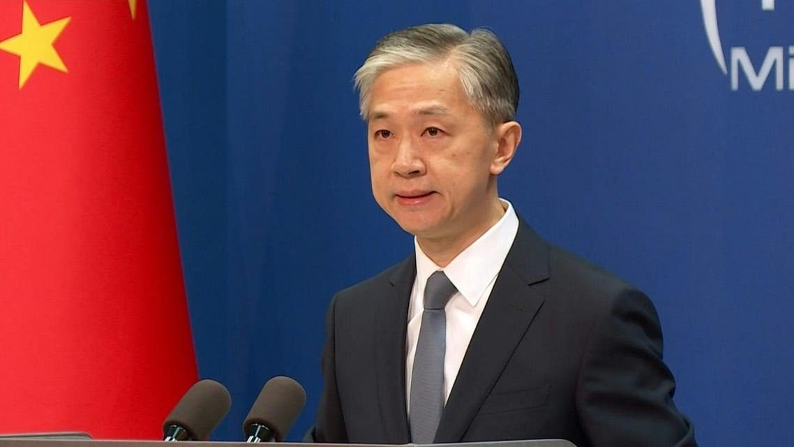 Chinese Foreign Ministry Spokesperson Wang Wenbin arriving at regular foreign ministry news conference in Beijing, China, July 22, 2020. (AFP)