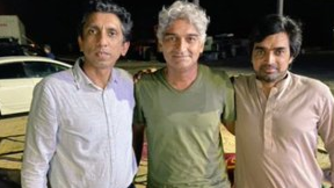Pakistani journalist Matiullah Jan (c) with two fellow journalists in an unspecified location. (Twitter)
