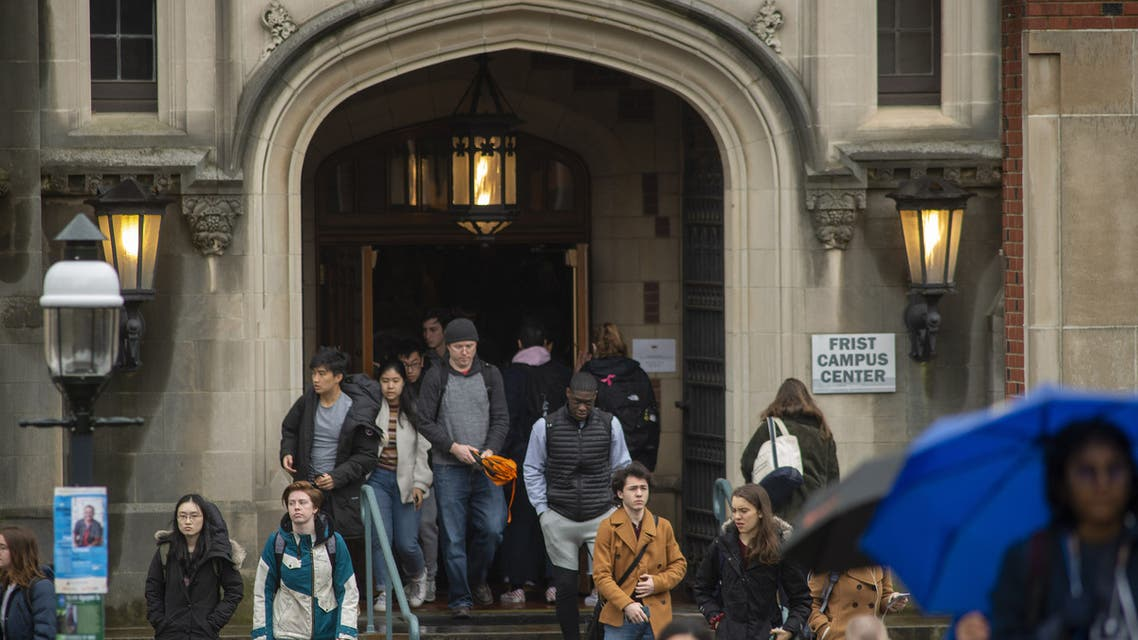Students exit a building between classes at Princeton University on February 4, 2020 in Princeton, New Jersey. (AFP)