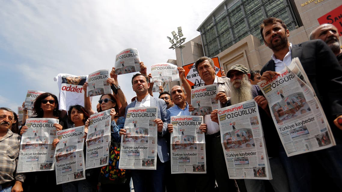 Press freedom activists hold copies of the opposition newspaper Cumhuriyet during a demonstration in solidarity with the jailed members of the newspaper outside a courthouse, in Istanbul, Turkey, July 28, 2017. REUTERS/Murad Sezer
