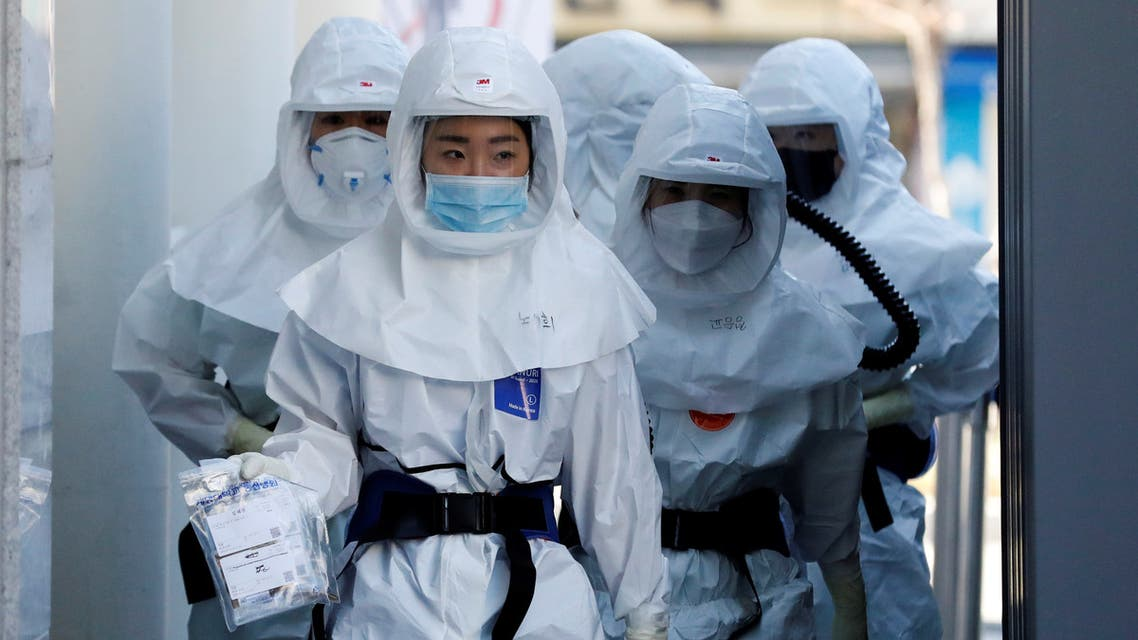 Medical workers head to a hospital facility to treat coronavirus patients amid the rise in confirmed cases of coronavirus disease (COVID-19) in Daegu, South Korea, March 14, 2020. REUTERS/Kim Kyung-Hoon