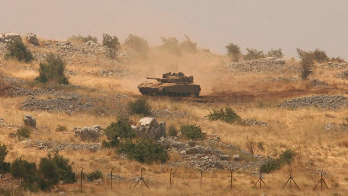 An Israeli tank patrols the Shebaa Farms area, wedged between Lebanon and the Israeli-occupied Golan Heights July 8, 2009. (Reuters)