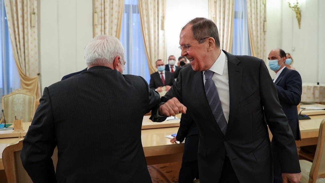 Russian Foreign Minister Sergei Lavrov and his Iranian counterpart Mohammad Javad Zarif greet each other, in Moscow, on July 21, 2020. (AFP)