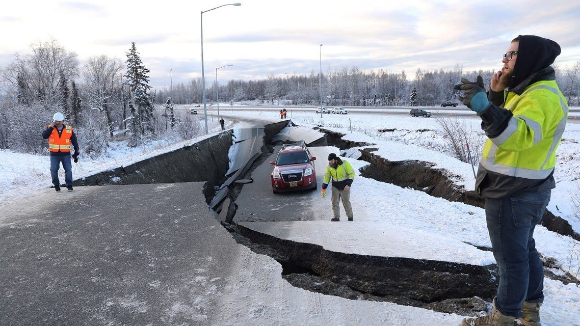 A stranded vehicle lies on a collapsed roadway near the airport after an earthquake in Anchorage, Alaska, U.S. (Reuters)