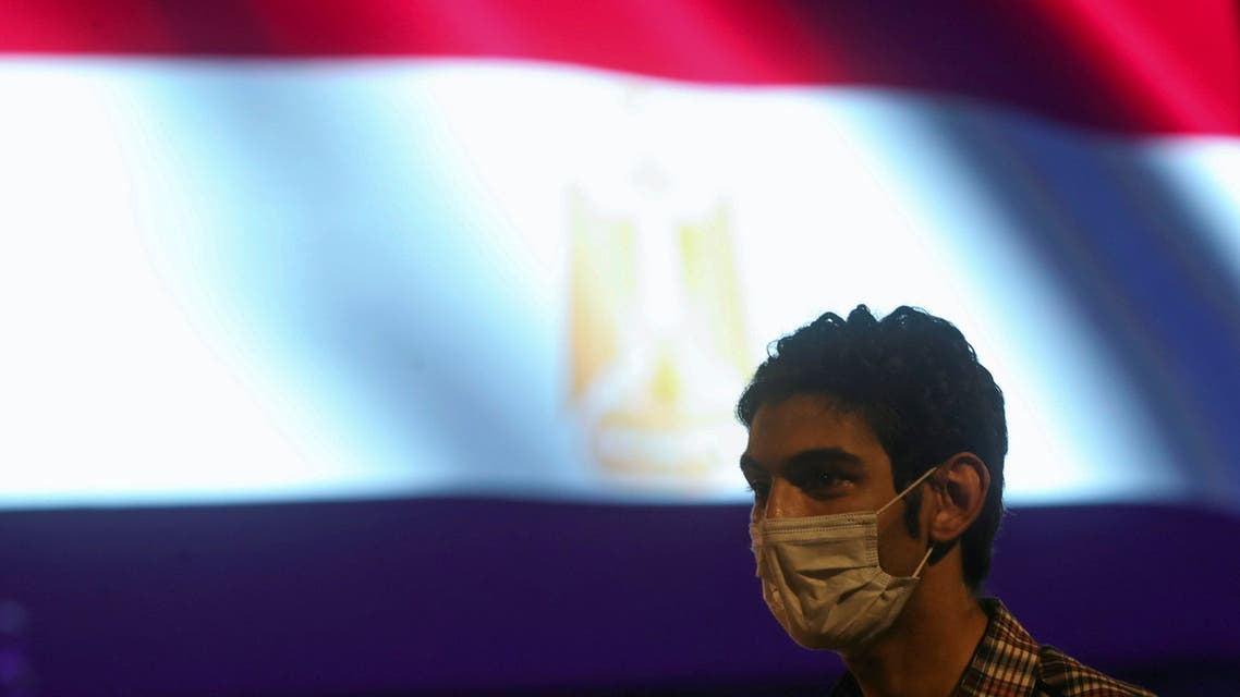 A man wearing protective face mask listens to the first concert of the Cairo Symphonic Orchestra after the Cairo Opera House reopened, amid concerns about the spread of the coronavirus disease (COVID-19), in Cairo, Egypt July 18, 2020. REUTERS/Mohamed Abd El Ghany