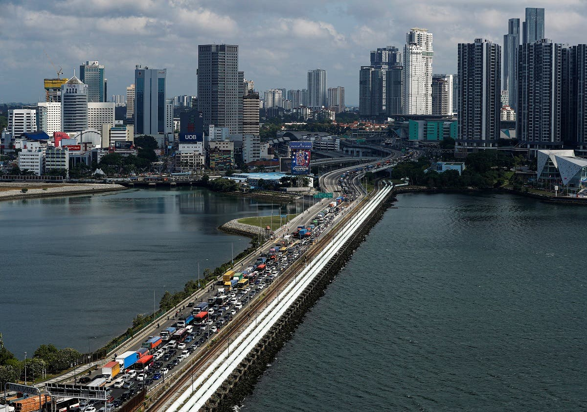 Commuters take the Woodlands Causeway to Singapore from Johor a day before Malaysia imposes a lockdown on travel due to the coronavirus outbreak in Singapore on March 17, 2020. (Reuters)