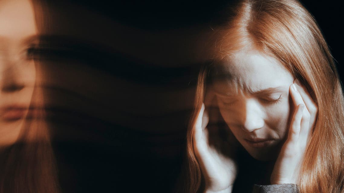 Young woman experiencing hallucinations stock photo
