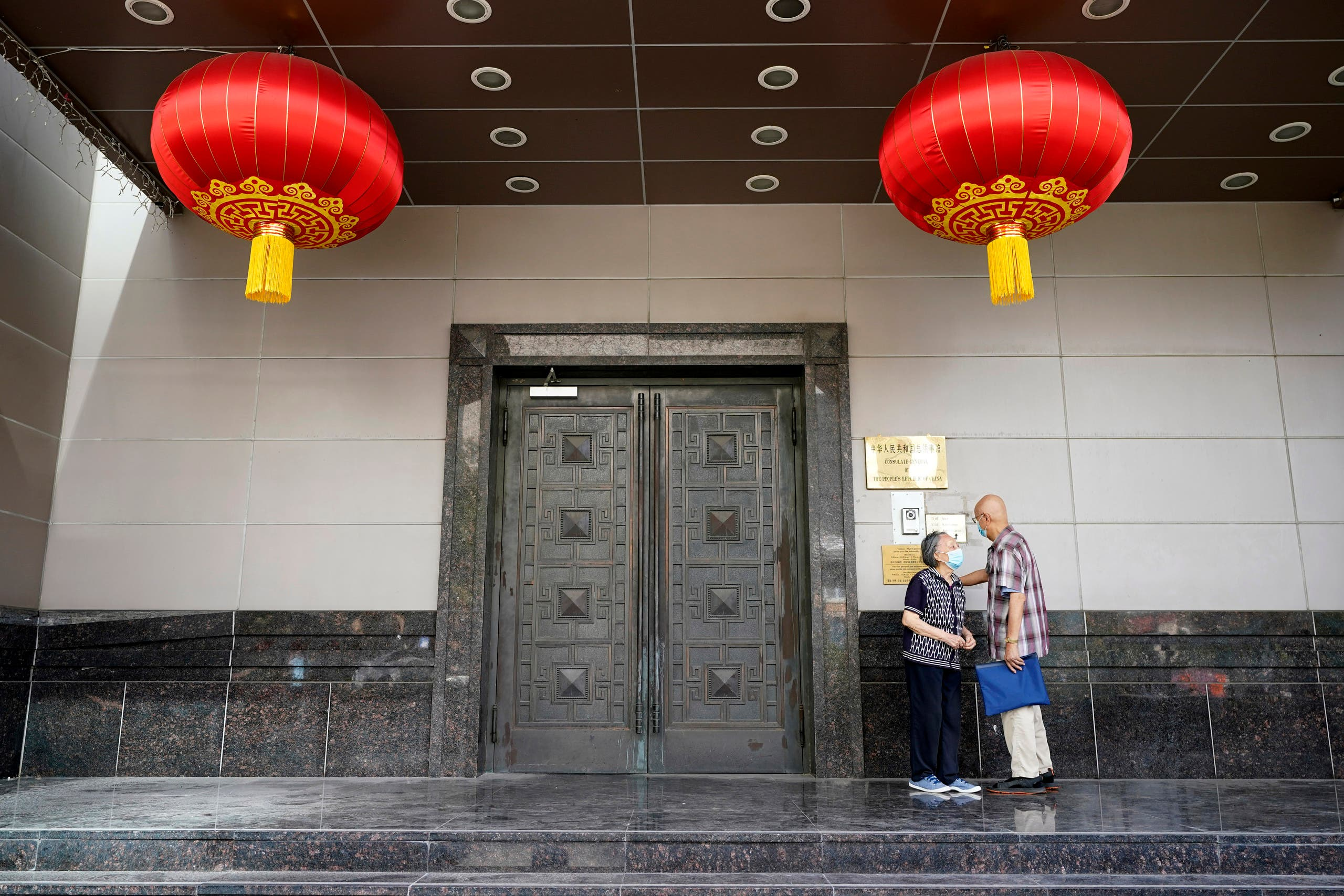 Visitors try to enter the Chinese Consulate General Wednesday, July 22, 2020, in Houston. (AP)