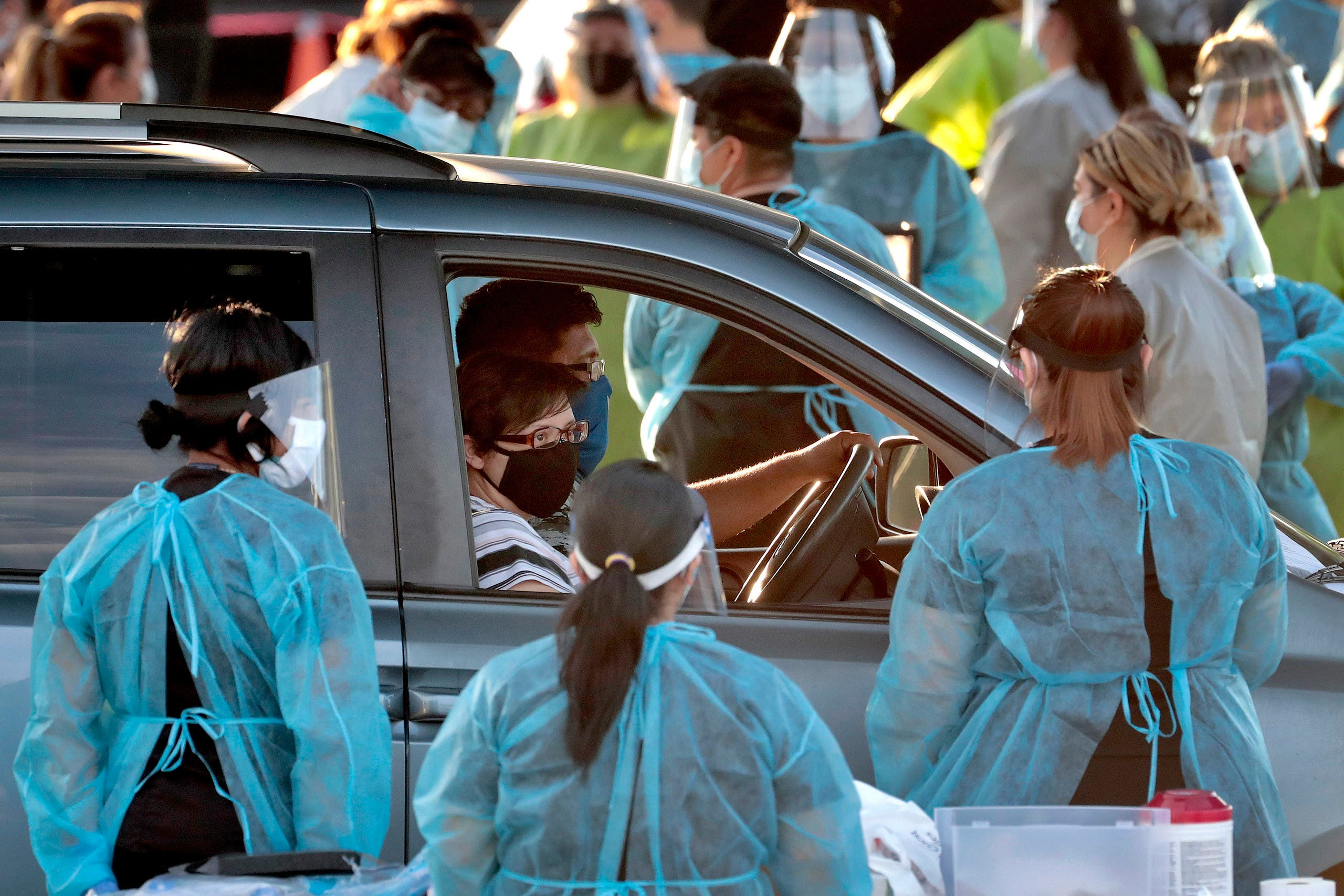 A family pulls up to a drive -thru testing site in Phoenix's western neighborhood of Maryvale on June 27, 2020. (AP)