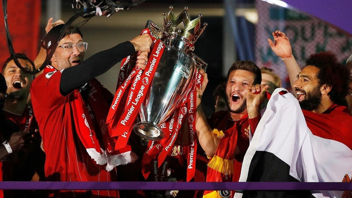 Liverpool manager Juergen Klopp, Adam Lallana and Mohamed Salah celebrate with the trophy after winning the Premier League. (Reuters)