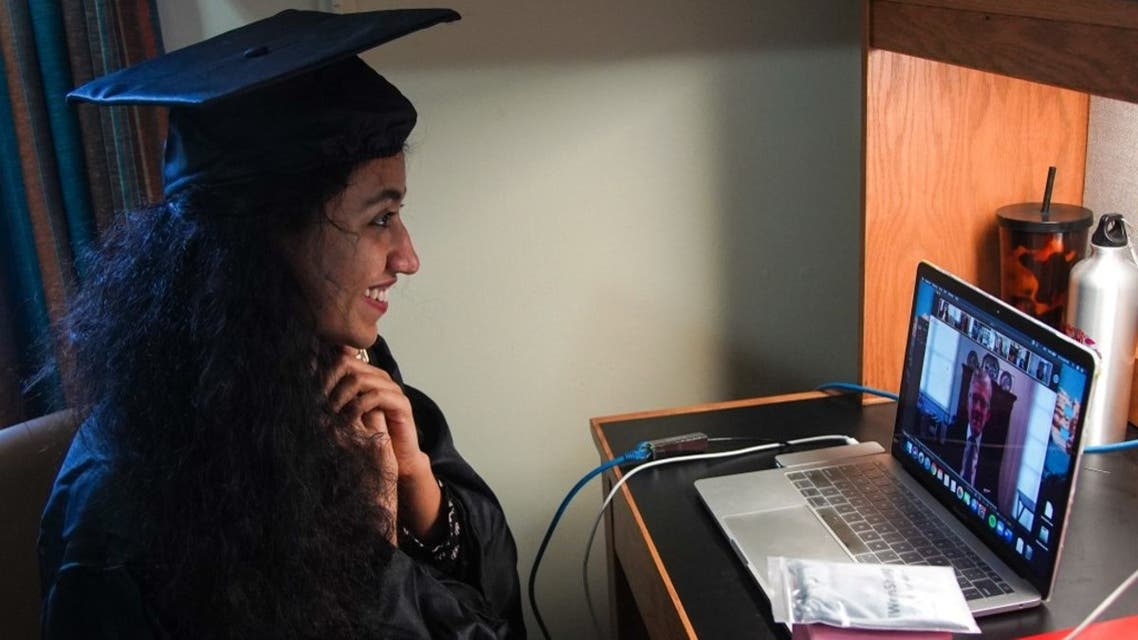 Pakistani student attends her graduation ceremony online in her bedroom due to the coronavirus pandemic, at Georgetown University, in Washington, DC, May 15, 2020. (AFP)
