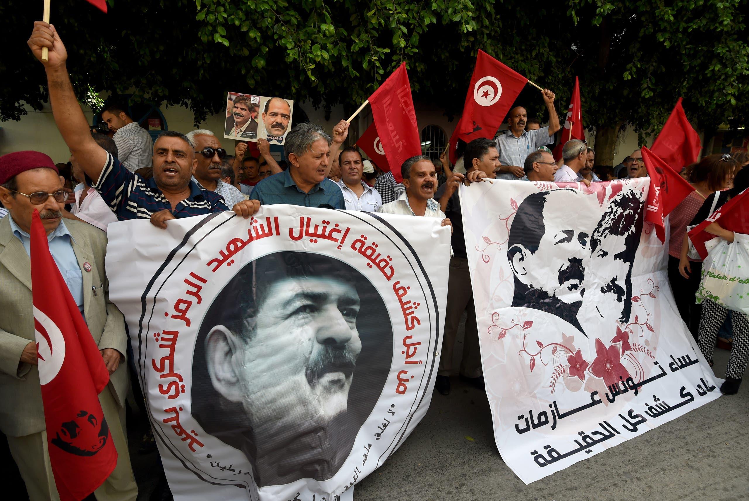مظاهرات للمطالبة بكشف قتلة شكري بلعيد والبراهيمي في تونس (أرشيفية فرانس برس)