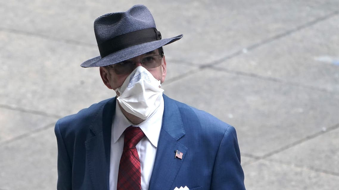 A man dressed in business attire wears a protective mask, following the outbreak of coronavirus disease (COVID-19) in the Manhattan borough of New York City, New York, U.S., July 23, 2020. (Reuters)