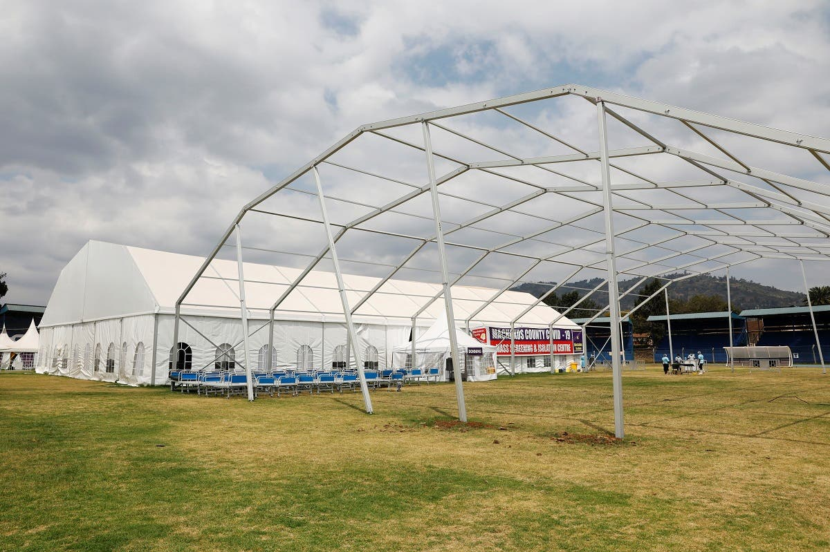 A frame of a new structure is seen next to a field hospital built on a soccer stadium in Machakos, as the number of confirmed coronavirus disease (COVID-19) cases continues to rise in Kenya, July 23, 2020. Picture taken July 23, 2020. (Reuters)