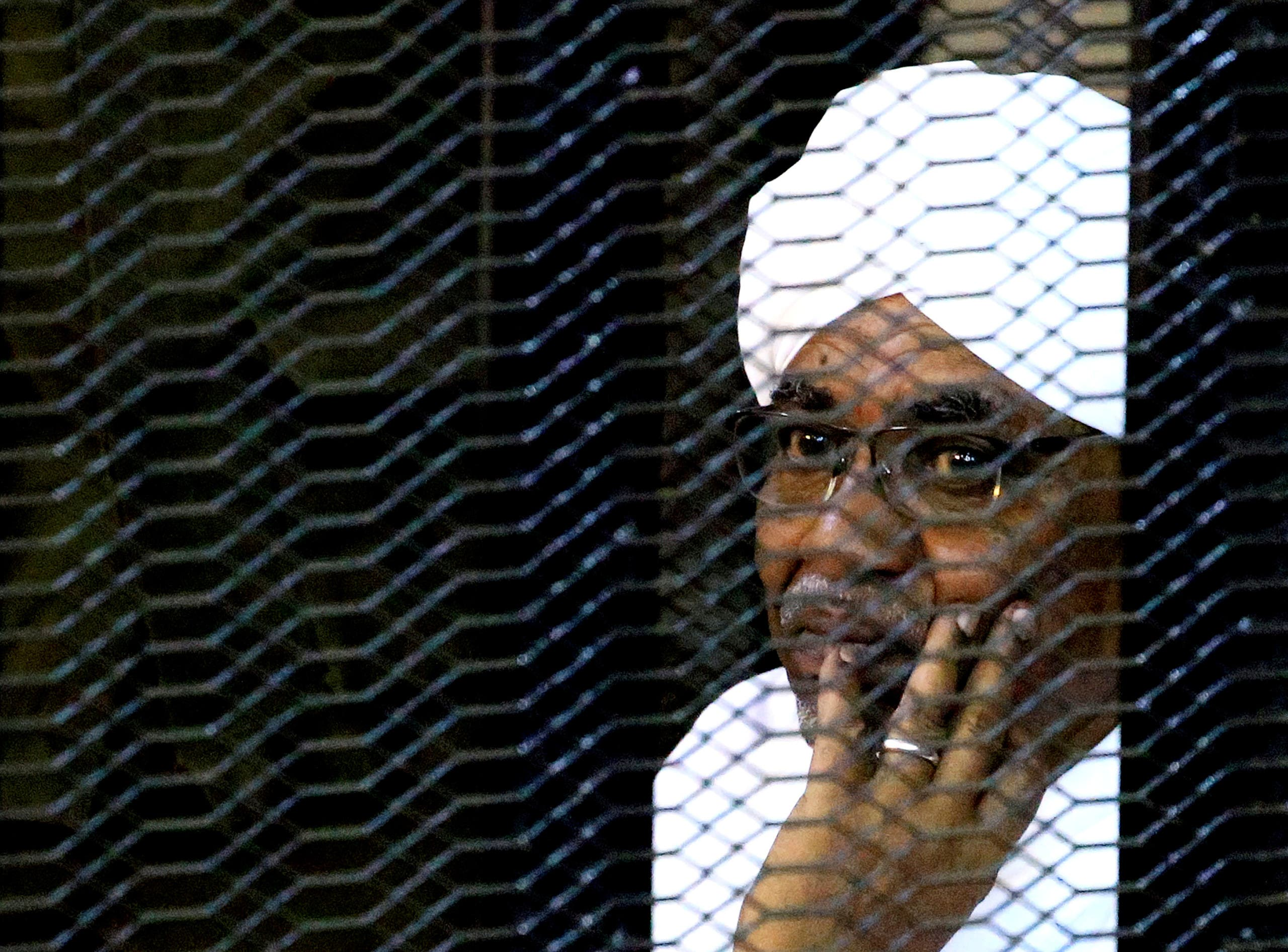 Sudan's former President Omar al-Bashir sits inside a cage at the courthouse where he is facing corruption charges, in Khartoum, Sudan, September 28, 2019. (File photo: Reuters)