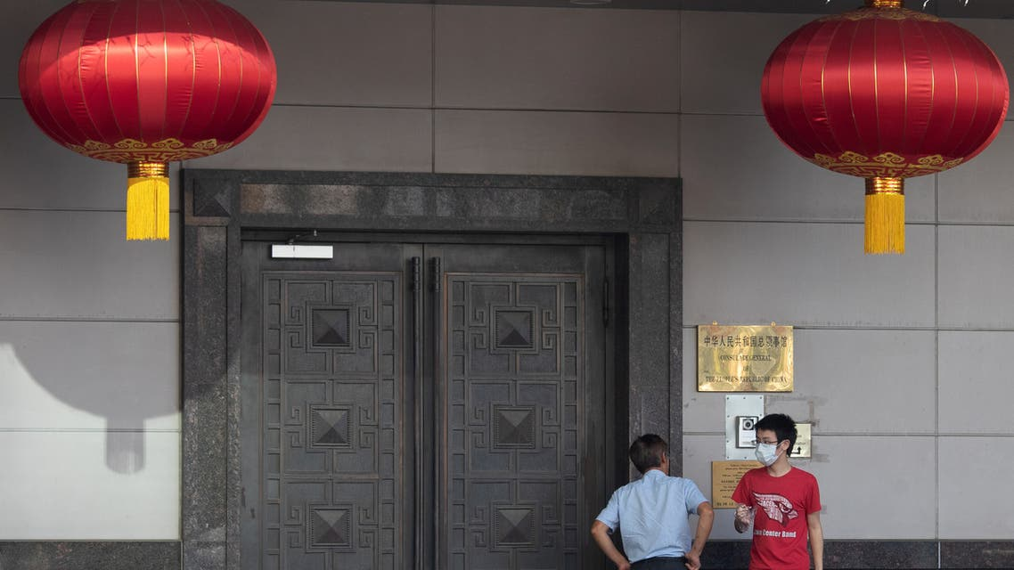 Men try to gain access into the China Consulate General in Houston, Texas, U.S., July 22, 2020. (Reuters)